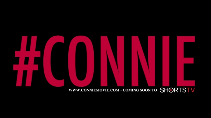 Connie red on black with shortsTV logo